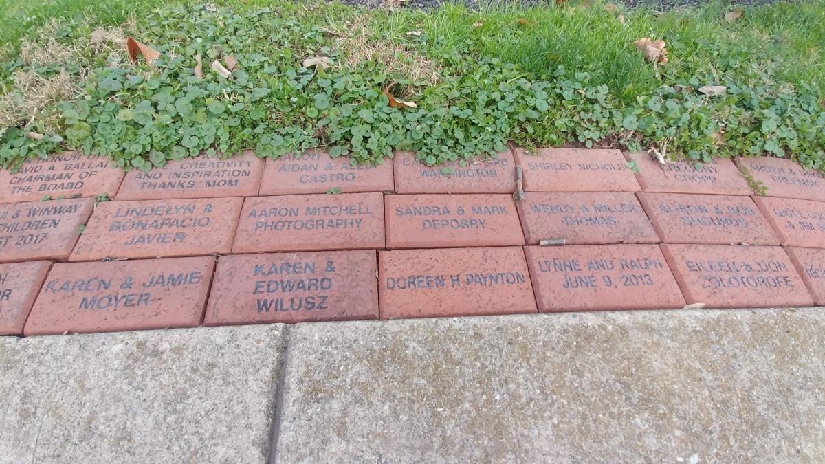 Brick path called Preservation Walkway