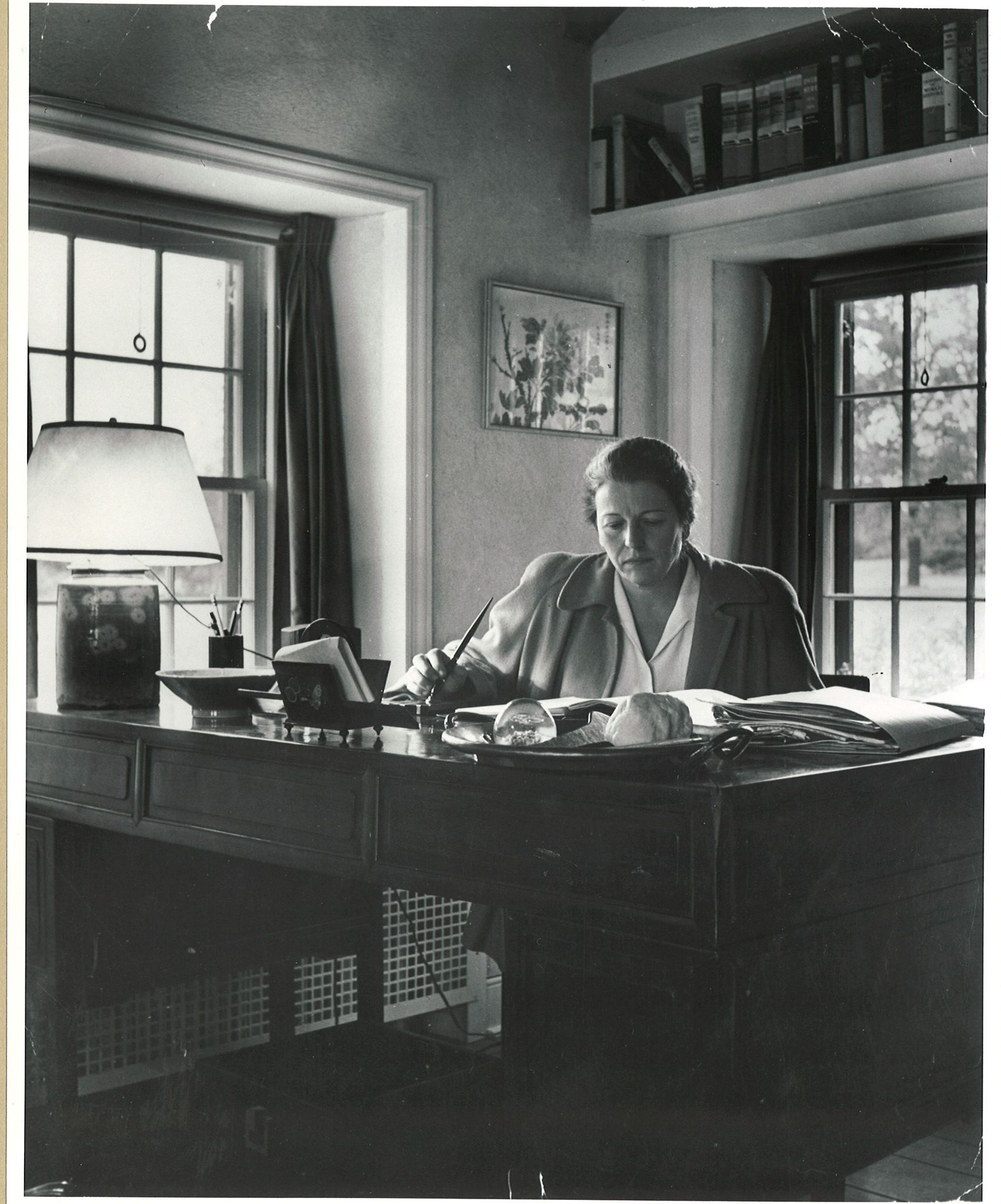Pearl Buck sitting at her desk
