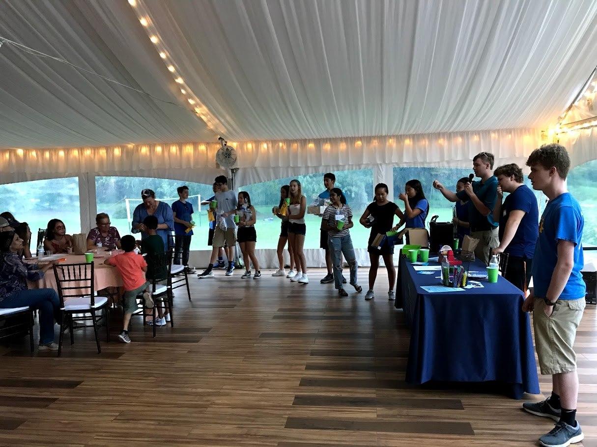People inside tent for Global Leadership fundraiser