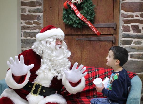 Santa sits with a boy