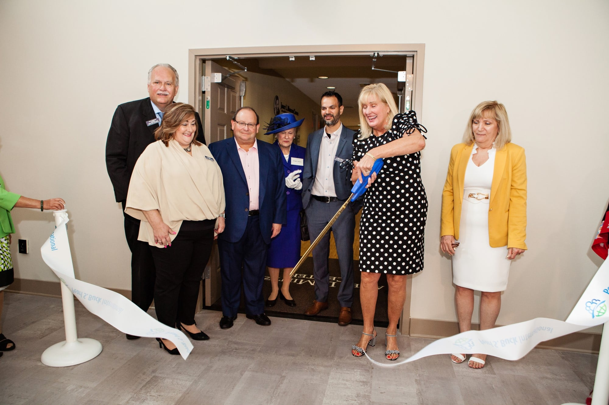 Pearl S. Buck International leadership and board members cut the ribbon at the grand opening of the Janet L. Mintzer Center