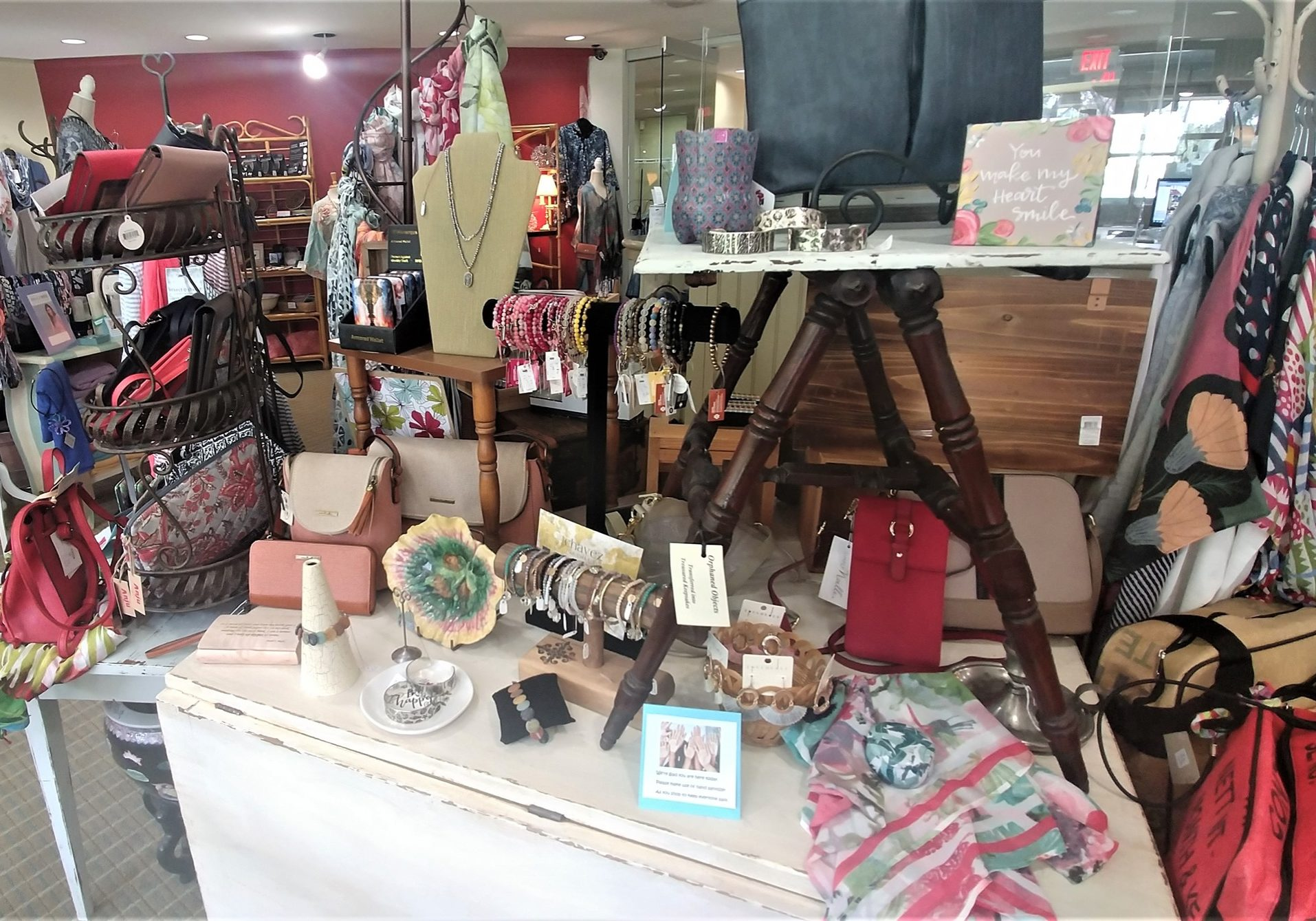 Gift shop items like jewelry, purses, bags, and clothing