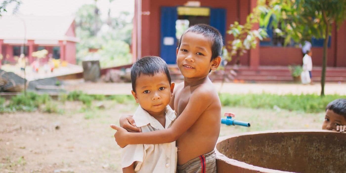 Boys in Cambodia hugging